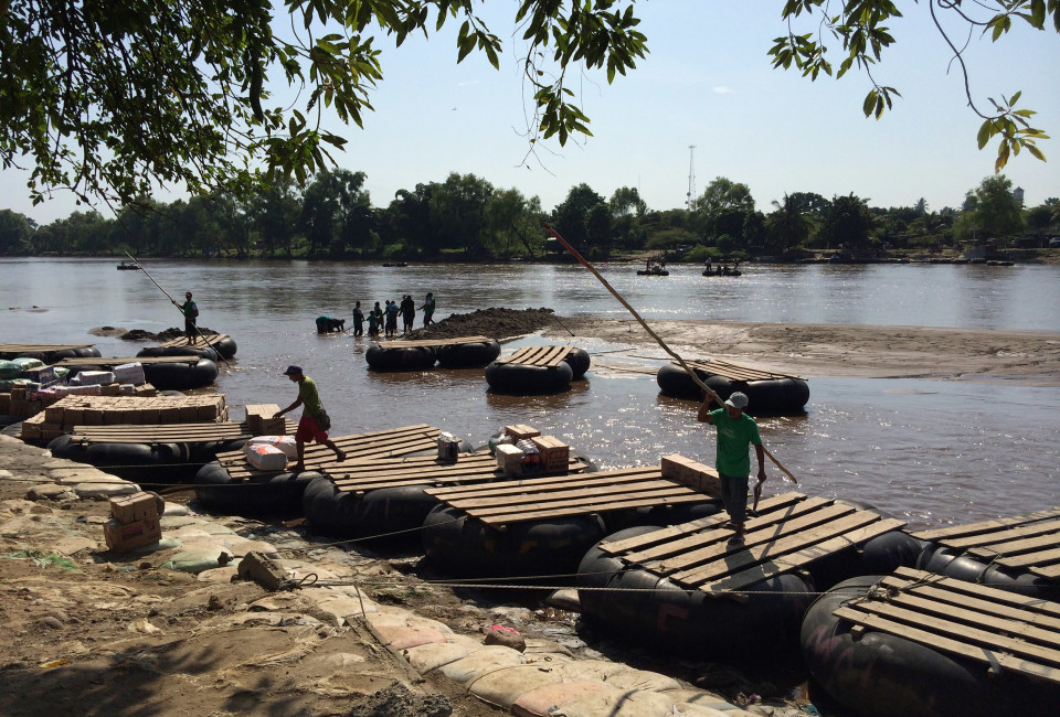 A makeshift pier in Ciudad Hidalgo, on the banks of the border river Suchiate, which separates Mexico and Guatemala. The rafts smuggle merchandise to Guatemala and transport undocumented migrants on the way back.