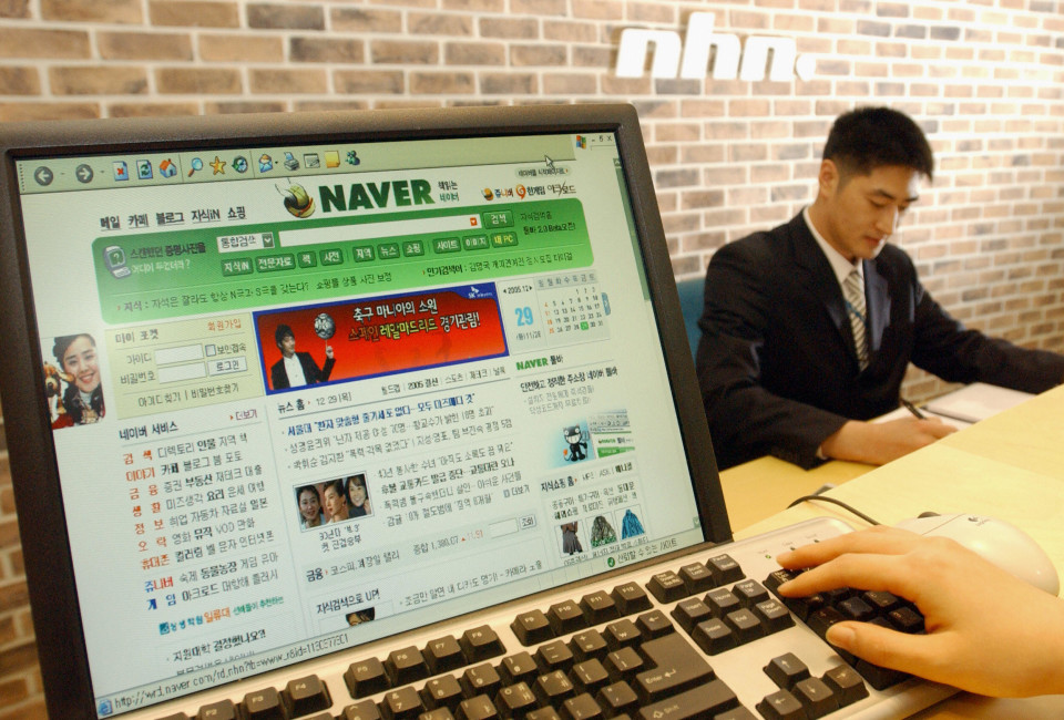A visitor searches an internet portal service of South Korea's on-line media company, NHN.