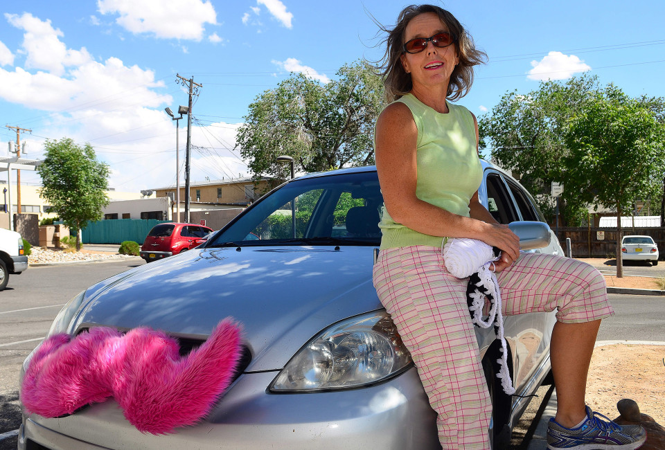 May 21, 2014 - Albuquerque, NEW MEXICO, U.S. - 052114 .Lyft driver Carrie Ann Drinville,, crochets while waiting for customer calls in the UNM area . Photographed on Wednesday May 21, 2014.  /Adolphe Pierre-Louis/Journal. (Credit Image: © Adolphe Pierre-Louis/Albuquerque Journal/ZUMAPRESS.com)