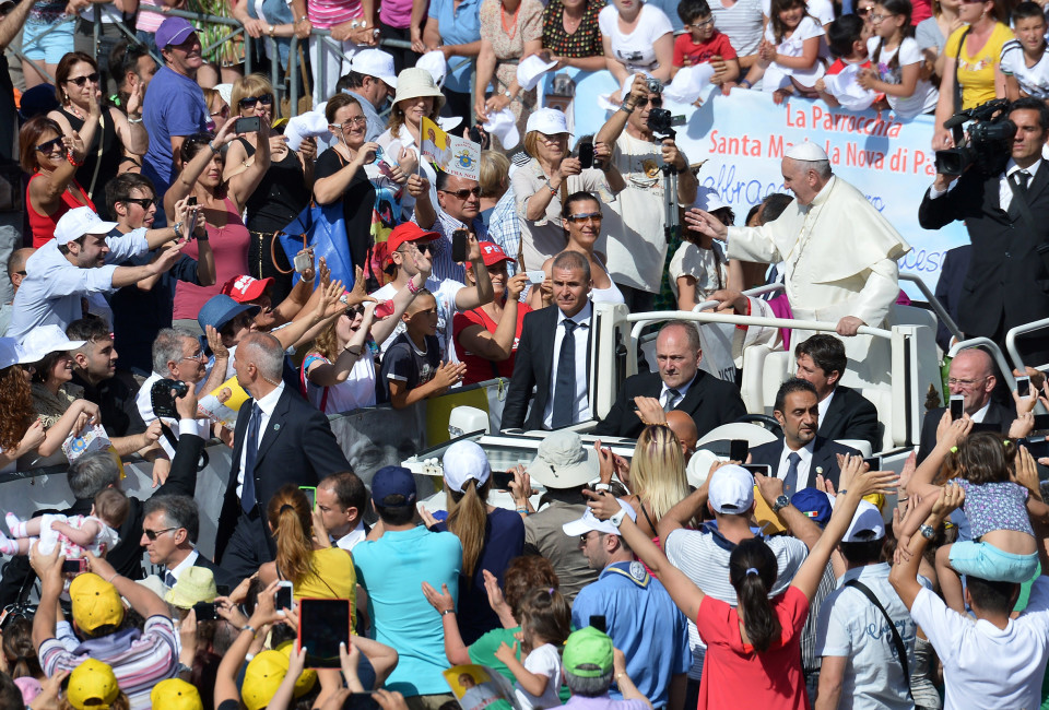 Pope Francis greets the crowd from the popemobile as he arrives to preside a holy mass on July 5, 2014 in Campobasso, southern Italy, as part of his one day visit in the Molise region.