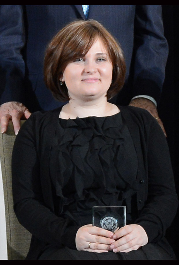 Elena Milashina of Russia with her International Women of Courage Award at the 2013 awards ceremony.