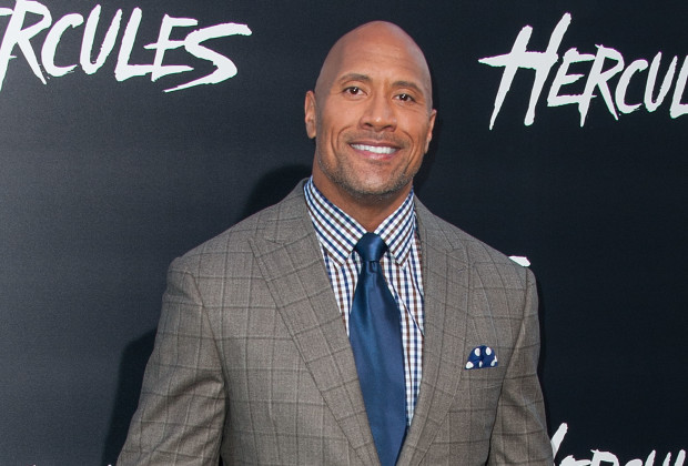 """HOLLYWOOD, CA - JULY 23:  Actor Dwayne Johnson arrives at the Premiere Of Paramount Pictures' """"Hercules"""" at TCL Chinese Theatre on July 23, 2014 in Hollywood, California.  (Photo by Valerie Macon/Getty Images)"""
