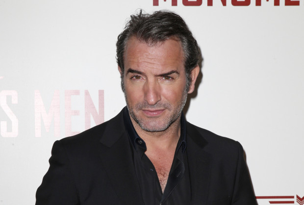 """Cast member Jean Dujardin arrives for the French premiere of the film """"The Monuments Men"""" in Paris February 12, 2014. REUTERS/Benoit Tessier (FRANCE - Tags: ENTERTAINMENT) - RTX18P4M"""
