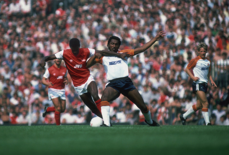Arsenal midfielder Paul Davis is challenged by Luton player Ricky Hill during the opening match of the season at the Arsenal Stadium in Highbury, North London, 27th August 1983.