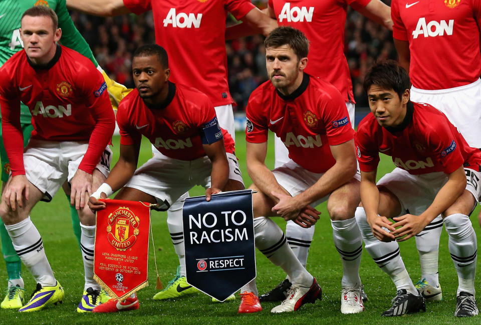 L-R) Wayne Rooney, Patrice Evra, Michael Carrick and Shinji Kagawa of Manchester United line up with a No to Racism pennant prior to the UEFA Champions League Group A match between Manchester United and Real Sociedad at Old Trafford on October 23, 2013 in Manchester, England.