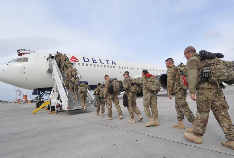US soldiers from the 438th Medical Unit board a plane on their way to the homeland from Afghanistan at the US transit center Manas, 30 km outside the Kyrgyzstan's capital Bishkek, on March 21, 2013. International coalition forces are to exit Afghanistan by the end of next year, leaving local forces to take on fighting the Taliban alone. AFP PHOTO / VYACHESLAV OSELEDKO        (Photo credit should read VYACHESLAV OSELEDKO/AFP/Getty Images)