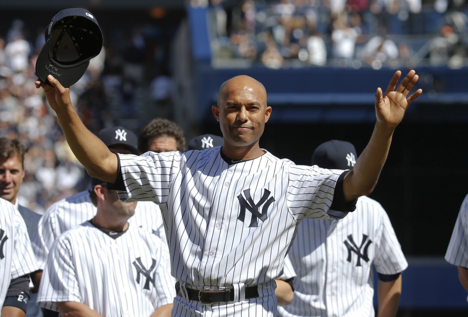 New York Yankees relief pitcher Mariano Rivera responds to the sold-out crowd during ceremonies honoring him before their MLB Interleague baseball game against the San Francisco Giants at Yankee Stadium in New York September 22, 2013. REUTERS/Ray Stubblebine (UNITED STATES - Tags: SPORT BASEBALL) - RTX13V6D