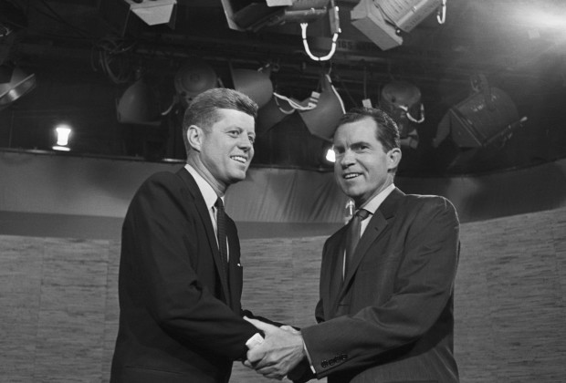 07 Oct 1960, Washington, DC, USA --- Presidential candidates John F. Kennedy and Richard Nixon shake hands after their televised debate of October 7, 1960. The two opponents continued their debate after the cameras had stopped. --- Image by © Bettmann/CORBIS