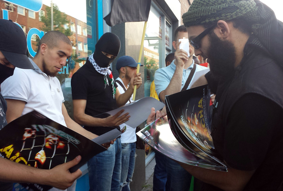 During a pro ISIS rally in The Hague, the Netherlands in July 2014, a brochure is handed out by someone wearingan ISIS jacket requesting  'Free Aseer', which is an islamic organization that wants to free Dutch muslims from prison.