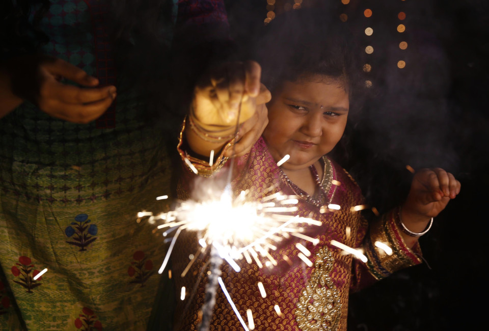 A child plays with firecrackers during Diwali celebrations in Allahabad, India,Thursday, Oct. 23, 2014. Diwali, the festival of lights, is one of Hinduism's most important festivals dedicated to the worship of Lakshmi, the Hindu goddess of wealth.