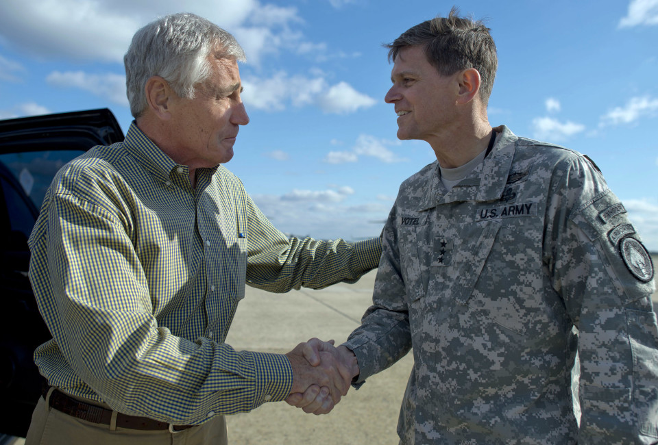 Secretary of Defense Chuck Hagel greets Lieutenant General Joseph L. Votel, commander of Joint Special Operations Command April 23, 2014.  Hagel is traveling to Ft. Bragg North Carolina to visit military members with the command, receive  briefings and view unit demonstrations and capabilities. DoD Photo by Erin A. Kirk-Cuomo (Released)