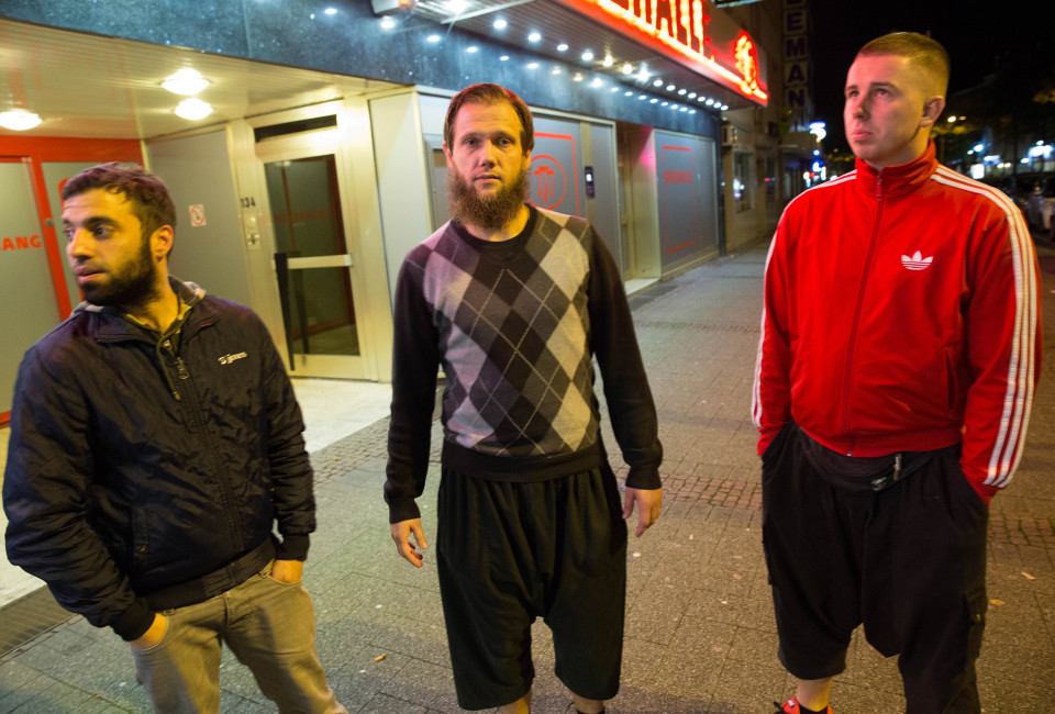Yunus Sahin, 27, on the left, Sven Lau in the middle and Isa Schneider, 23, outside of a casino in Wuppertal.