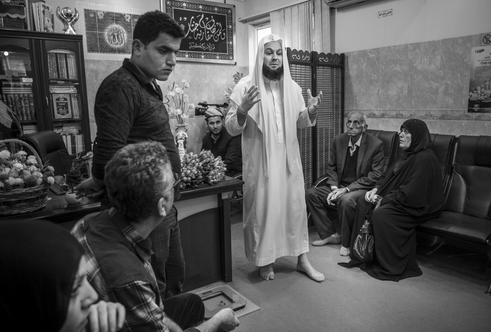 Mala Ali Kalak sees patients in a village outside of Erbil in Iraqi Kurdistan. Patients come from all over Iraq to get cured by him. He prayers over them, prescribes ointments, pills and camel milk or urine and chases the devils out of people.