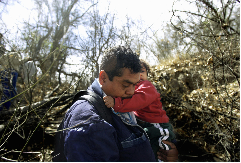Buenos Aires Wild Refuge, UNITED STATES:  A father and daughter along with a group of immigrants walk through the Buenos Aires National Wild Refuge after they were detained in Arizona 16 March, 2006. US President George W. Bush announced 15 May, 2006, he would send some 6,000 National Guard reservists to help US Border Patrol to stop the flow of illegal immigration along the US border with Mexico. The president also backed efforts to help an estimated 11.5 million undocumented immigrants in the US, more than half of whom are from Mexico, to work in the country legally.   AFP PHOTO/HECTOR MATA    =EDITORS: MORE IMAGES AVAILABLE IN IMAGE FORUM=  (Photo credit should read HECTOR MATA/AFP/Getty Images)