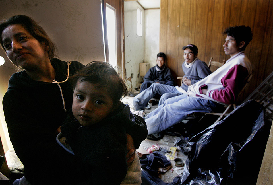 Arivaca, UNITED STATES:  A group of undocumented immigrants wait for transportation in a hideout location near Arivaca, Arizona 18 March 2006. The group of fourty immigrants, among them several children, walked for two days from the Mexican city of Altar into Southern Arizona. Following the implementation by the US Government of Operation Gate Keeper in Southern California and a similar operation in Texas, the majority of border crossing activities have moved to Arizona and New Mexico,with large deserts and mountains exposing them to harsher weather conditions. The number of illegal immigrants in the United States has grown to as many as twelve million people and they now account for about one in every twenty workers following a recent report by the Pew Hispanic Institute.  AFP PHOTO / HECTOR MATA / HMB  (Photo credit should read HECTOR MATA/AFP/Getty Images)