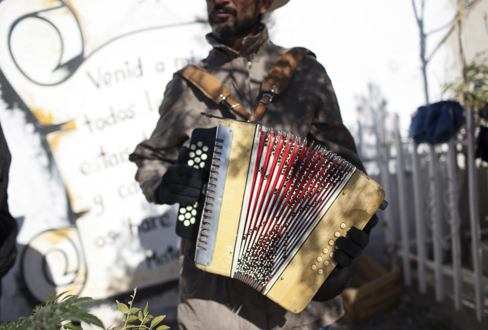 Mario Muñoz plays in front of a tomb at theTepeyac graveyard, in Ciudad Juárez, Mexico, Thursday, November 13, 2014. Muñoz is part of a group of musicians that perform in Tepeyac graveyard, the biggest in Juárez.