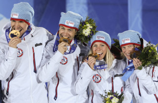 A picture taken with a robotic camera shows Norway's gold medalists Tora Berger, Tiril Eckhoff, Ole Einar Bjoerndalen and Emil Hegle Svendsen posing during the Biathlon mixed 2x6 km + 2x7.5 km Relay Medal Ceremony at the Sochi medals plaza during the Sochi Winter Olympics on February 20, 2014.  AFP PHOTO / ANTONIN THUILLIER        (Photo credit should read ANTONIN THUILLIER/AFP/Getty Images)