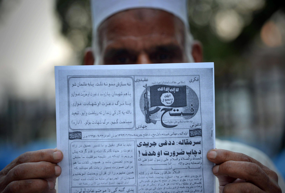 "This photograph taken on September 3, 2014 shows a Pakistani man holding a pamphlet, allegedly distributed by the Islamic State (IS), in the northwestern Pakistani city of Peshawar. The leaflets, titled 'Fatah' (Victory) and published in Pashto and Dari languages, are believed to be distributed by alleged IS militants in Peshawar and nearby border provinces, reports said. Al-Qaeda, which on September 4 announced a new South Asia front to ""wage jihad"" in neighbouring India, Bangladesh and Myanmar, once attracted jihadists from around the world to training camps on the Afghan-Pakistan border, but has seen its global influence eclipsed by the Islamic State (IS) jihadist group fighting in Iraq and Syria. AFP PHOTO/ A MAJEED        (Photo credit should read A Majeed/AFP/Getty Images)"