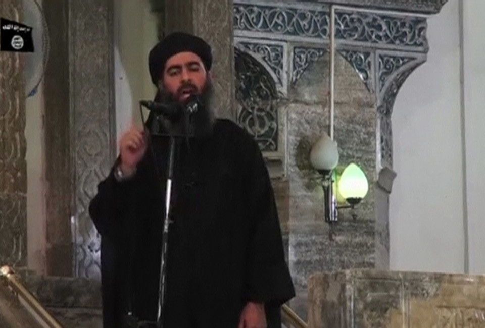 A man purported to be the reclusive leader of the militant Islamic State Abu Bakr al-Baghdadi has made what would be his first public appearance at a mosque in the centre of Iraq's second city, Mosul, according to a video recording posted on the Internet on July 5, 2014, in this still image taken from video. There had previously been reports on social media that Abu Bakr al-Baghdadi would make his first public appearance since his Islamic State in Iraq and the Levant (ISIL) changed its name to the Islamic State and declared him caliph. The Iraqi government denied that the video, which carried Friday's date, was credible. It was also not possible to immediately confirm the authenticity of the recording or the date when it was made. REUTERS/Social Media Website via Reuters TV (IRAQ - Tags: POLITICS) ATTENTION EDITORS - THIS IMAGE HAS BEEN SUPPLIED BY A THIRD PARTY. IT IS DISTRIBUTED, EXACTLY AS RECEIVED BY REUTERS, AS A SERVICE TO CLIENTS. REUTERS IS UNABLE TO INDEPENDENTLY VERIFY THE CONTENT OF THIS VIDEO, WHICH HAS BEEN OBTAINED FROM A SOCIAL MEDIA WEBSITE - RTR3X9BC