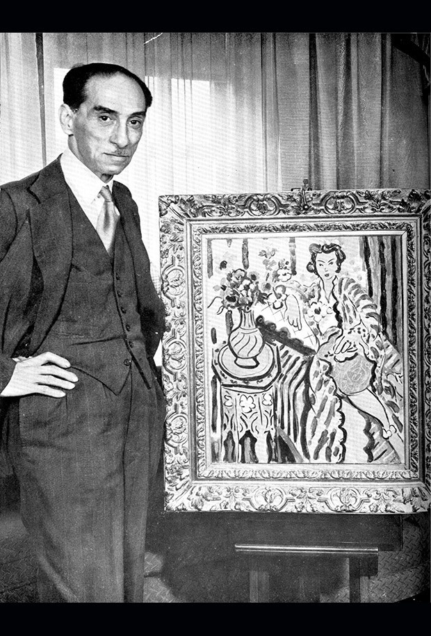 """Art dealer Paul Rosenberg is pictured next to Henri Matisse's painting """"Odalisque with Yellow Persian."""""""