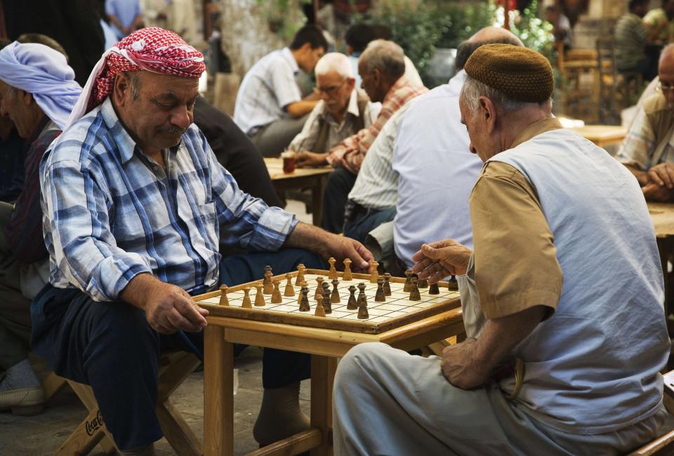Feb. 09, 2013 - Turkey, Urfa, Bazaar, in the open court of a tea house, men play a variant of chess (Credit Image: © TIPS/ZUMAPRESS.com)