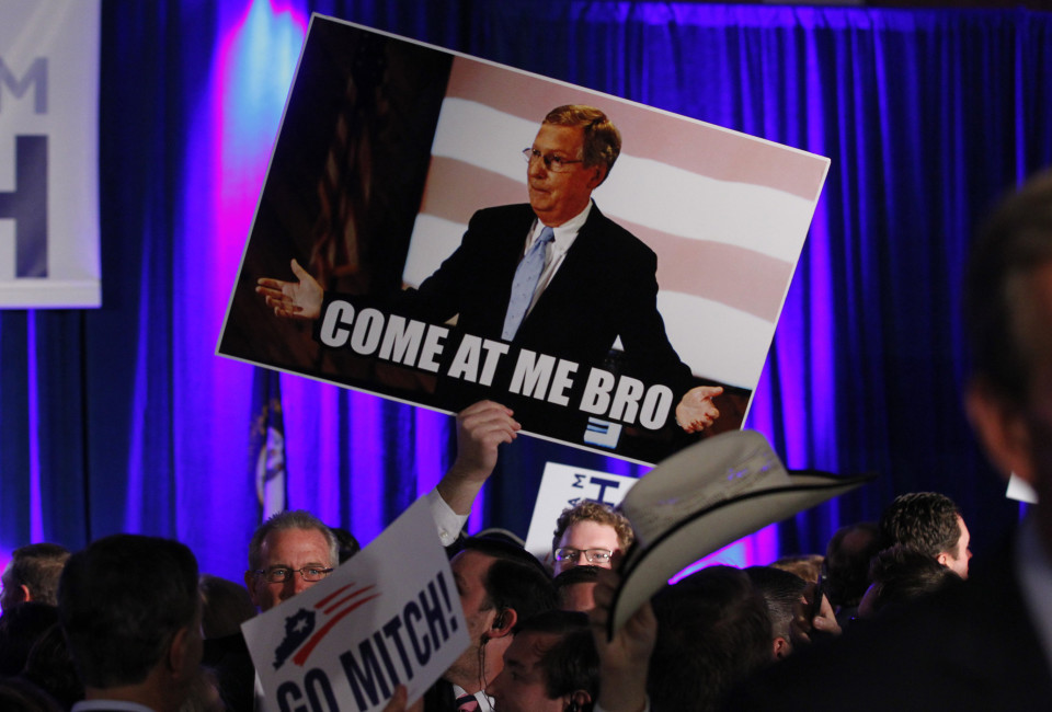 A supporter of U.S. Senate Minority Leader Mitch McConnell (R-KY) raises a sign at his midterm election night rally in Louisville, Kentucky November 4, 2014. Television news networks are projecting that McConnell will win the midterm election.      REUTERS/John Sommers II (UNITED STATES  - Tags: POLITICS ELECTIONS)   - RTR4CUEQ