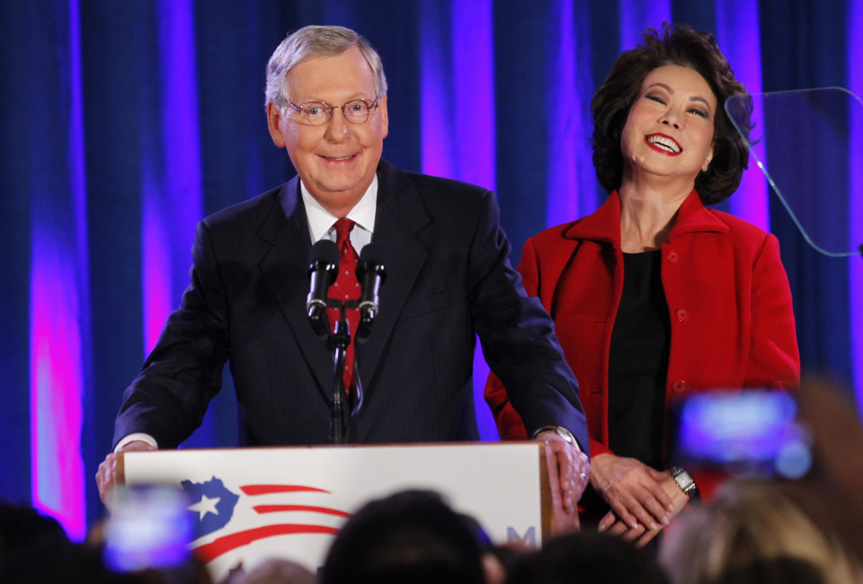 U.S. Senate Minority Leader Mitch McConnell (R-KY) addresses supporters while accompanied by his wife, former United States Secretary of Labor Elaine Chao, at his midterm election night rally in Louisville, Kentucky, November 4, 2014.  Television news networks are projecting that McConnell will win the election.        REUTERS/John Sommers II (UNITED STATES  - Tags: POLITICS ELECTIONS)   - RTR4CUKO