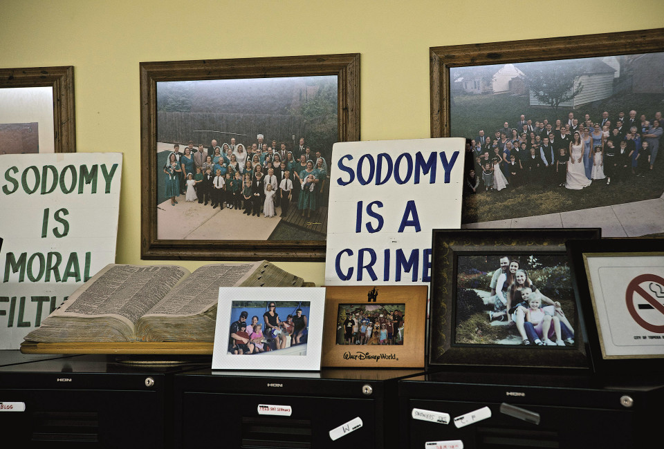 Pictures and signs on the wall of the Basement office of the westboro Baptist Church in Topeka Kansas.