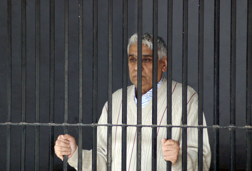 "Satguru Rampalji Maharaj, a self-styled ""godman"" is seen inside a police lock-up after his arrest, at Panchkula in the northern Indian state of Haryana November 20, 2014. A self-styled Indian religious leader was charged on Thursday with sedition and waging war against the state after a days-long siege of his sprawling compound ended in his arrest along with 450 hardcore followers. Police evacuated more than 10,000 followers on Wednesday from the fortified compound of a bizarre cult headed by 'godman' Satguru Rampalji Maharaj before capturing him late in the evening. REUTERS/Stringer (INDIA - Tags: RELIGION CRIME LAW CIVIL UNREST TPX IMAGES OF THE DAY) - RTR4EU53"