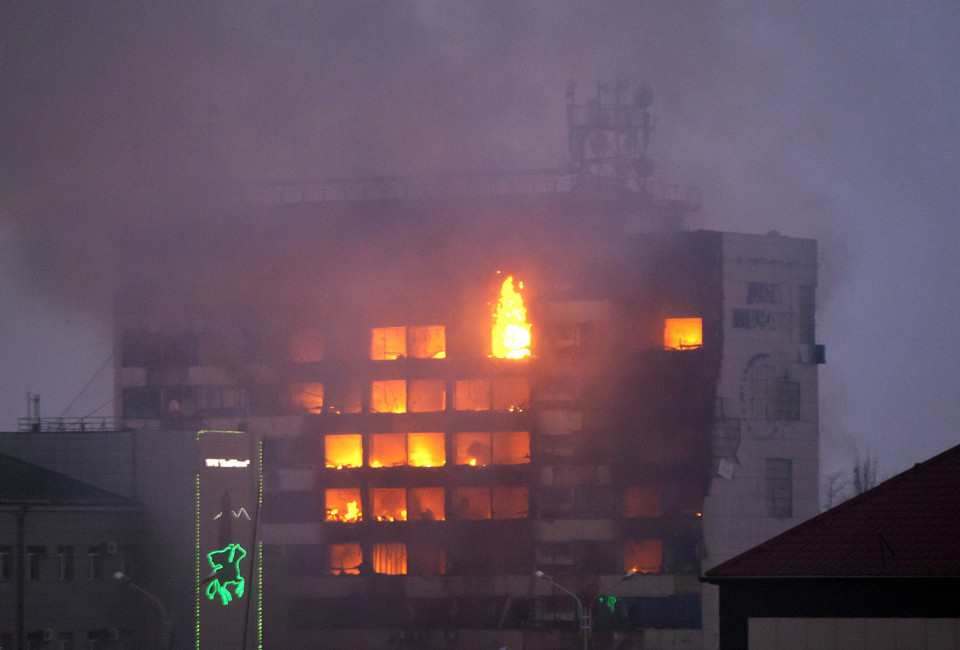 The media building burns as militants attack in central Grozny on December 4, 2014. Several police died in clashes with militants who attacked a traffic post in the Chechen capital Grozny and then stormed a building housing local media, Russian officials said on Thursday. AFP PHOTO/ELENA FITKULINA        (Photo credit should read ELENA FITKULINA/AFP/Getty Images)