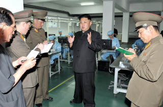 North Korean leader Kim Jong-Un visits the May 11 Factory in this undated photo released by North Korea's Korean Central News Agency (KCNA) in Pyongyang August 11, 2013. REUTERS/KCNA (NORTH KOREA - Tags: POLITICS BUSINESS TELECOMS) ATTENTION EDITORS - THIS PICTURE WAS PROVIDED BY A THIRD PARTY. REUTERS IS UNABLE TO INDEPENDENTLY VERIFY THE AUTHENTICITY, CONTENT, LOCATION OR DATE OF THIS IMAGE. FOR EDITORIAL USE ONLY. NOT FOR SALE FOR MARKETING OR ADVERTISING CAMPAIGNS. NO THIRD PARTY SALES. NOT FOR USE BY REUTERS THIRD PARTY DISTRIBUTORS. THIS PICTURE IS DISTRIBUTED EXACTLY AS RECEIVED BY REUTERS, AS A SERVICE TO CLIENTS - RTX12GZH