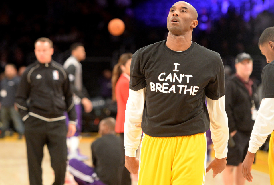 Los Angeles Lakers guard Kobe Bryant (24) wears a t-shirt during warm ups before the game against the Sacramento Kings to show support for the family of Eric Garner at Staples Center.