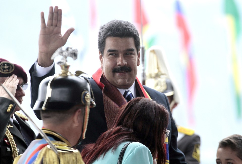 Venezuela's President Nicolas maduro waves during the inauguration of the UNASUR headquarters in Quito on December 5, 2014.  AFP PHOTO/JUAN CEVALLOS.        (Photo credit should read JUAN CEVALLOS/AFP/Getty Images)