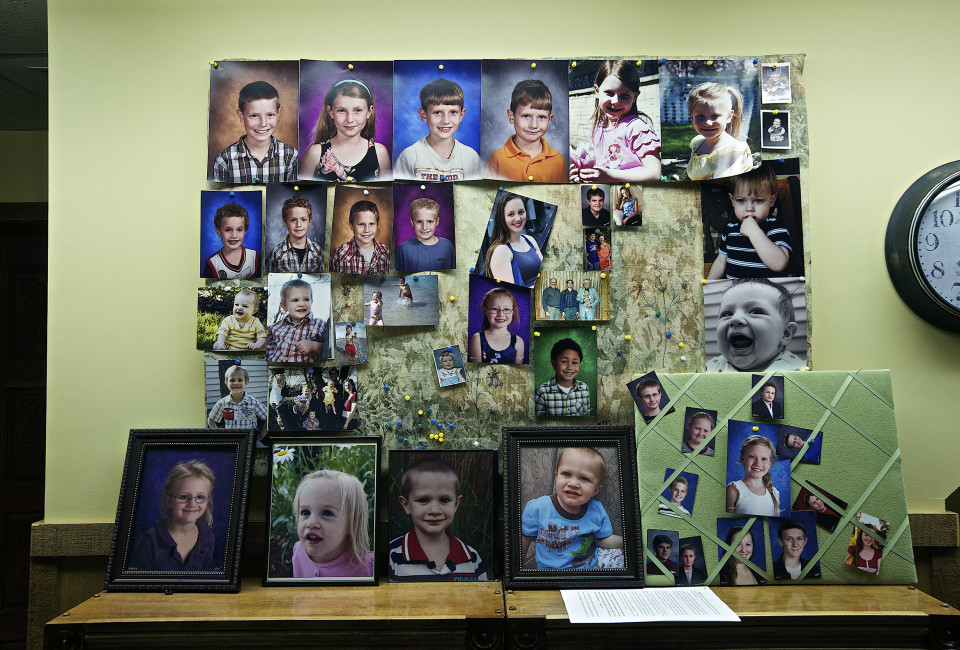Photographs of the children of the Westboro Baptist Church on the wall of the  basement office of the church in Topeka Kansas.