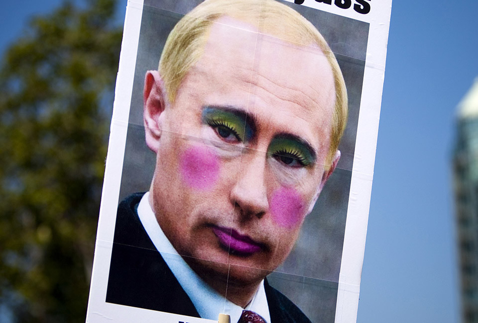 A sign is displayed of a defaced picture of Russia's President Vladimir Putin during Vancouver's 35th annual Pride Parade in Vancouver, British Columbia August 4, 2013.   REUTERS/Ben Nelms    (CANADA - Tags: SOCIETY) - RTX12ALY