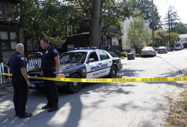 WALTHAM, MA - SEPTEMBER 13: Waltham police have closed off Harding Avenue in Waltham, the day after three men were found dead. The house is the yellow house to the right of the brown house on left. (Photo by Joanne Rathe/The Boston Globe via Getty Images)
