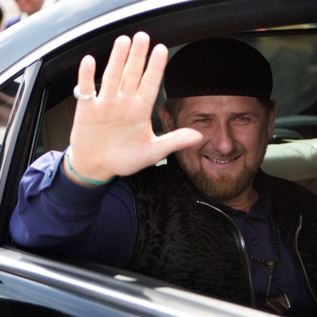 Chechen President Ramzan Kadyrov (C) waves to the crowd following a dedication ceremony of a new mosque in the Arab Israeli town of Abu Ghosh, west of Jerusalem on March 23 2014.The Chechen government contributed six million dollars to help fund the building of the new Mosque. AFP PHOTO/MENAHEM KAHANA        (Photo credit should read MENAHEM KAHANA/AFP/Getty Images)