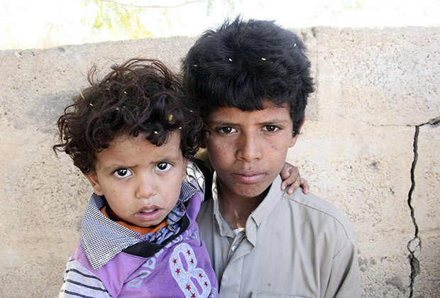 Mohammed Saleh Qayed Taeiman (R) poses for a photo with his younger brother outside their family's house in Marib province, Yemen, in this October 29, 2013 photo. A Yemeni rights group said on January 27, 2015 a sixth grade student aged about 12 was killed in a U.S. drone strike east of the capital Sanaa, an assertion that could raise fresh concern over Washington's campaign against suspected militants. The group said Mohammed Saleh Qayed Taeiman was one of three people reported killed in Monday's drone strike. It said his father and older brother were killed in a 2011 drone strike, and a third brother (not pictured) was wounded in another drone attack.