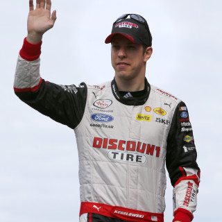 DAYTONA BEACH, FL - FEBRUARY 21:  Brad Keselowski, driver of the #22 Discount Tire Ford, takes part in pre-race ceremonies for the NASCAR XFINITY Series Alert Today Florida 300 at Daytona International Speedway on February 21, 2015 in Daytona Beach, Florida.  (Photo by Jerry Markland/Getty Images)