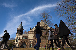 People walk around the Princeton University campus in New Jersey, November 16, 2013. A meningitis vaccine approved for use in Europe and Australia but not in the United States can be imported to try to stop an outbreak of the disease at Princeton University in New Jersey, federal health officials said. The Food and Drug Administration agreed this week to the importation of the vaccine, Bexsero, for potential use on the Ivy League campus, Barbara Reynolds, a spokeswoman for the Centers for Disease Control and Prevention, said on Saturday. REUTERS/Eduardo Munoz (UNITED STATES - Tags: SOCIETY EDUCATION HEALTH) - RTX15GEG