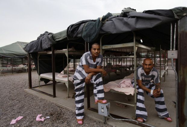 Inmates serving time at Maricopa County's Tent City jail pose for a picture in Phoenix, Arizona August 22, 2012. The controversial jail is run by Maricopa County Sheriff Joe Arpaio, who is seeking re-election for a sixth term during November's general election. Over 400,000 inmates have served time at Tent City. REUTERS/Joshua Lott (UNITED STATES - Tags: CRIME LAW SOCIETY ELECTIONS POLITICS) - RTR371RL