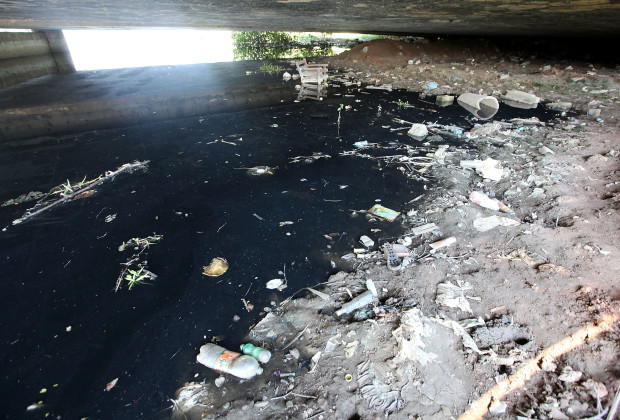 DUQUE DE CAIXAS, BRAZIL - JANUARY 30:  A polluted tributary of Guanabara Bay is shown littered with garbage near Rio de Janeiro on January 30, 2014 in Duque de Caxias, Brazil. Communities ring Guanabara Bay and most have been negatively affected by human and industrial pollution. The iconic bay will be the site of sailing events during the Rio 2016 Olympic Games. Although Rio's Olympic bid included the promise to clean up the filthy bay, industrial and human pollution still remain a major problem. According to the Deputy State Secretary of Environment just 34% of Rio's sewage is treated while the remainder flows untreated into the waters.  (Photo by Mario Tama/Getty Images)