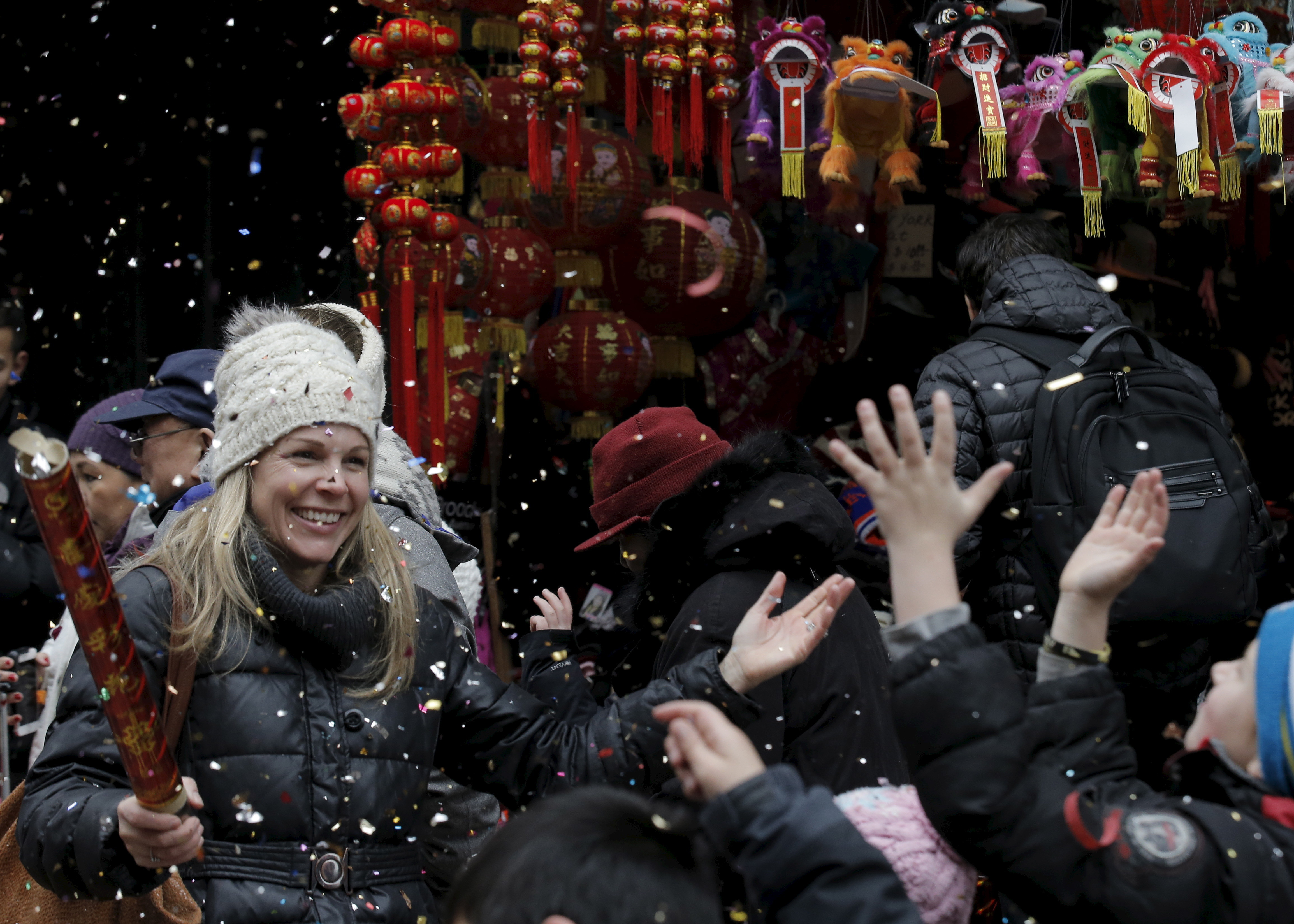 People celebrate the Chinese Lunar New Year in Manhattan's Chinatown in New York February 8, 2016. REUTERS/Brendan McDermid  - RTX262EG