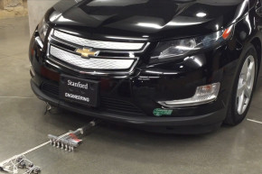 Watch Six Tiny Robots Pull A Chevy