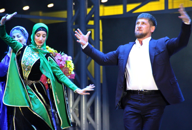 Chechen leader Ramzan Kadyrov (R) dances during a performance in Grozny late on October 5, 2011. Chechen strongman Ramzan Kadyrov turned 35 today with congratulatory calls from Russia's ruling duo and Hollywood stars attending grandiose celebrations in the Caucasus republic. AFP PHOTO / STRINGER (Photo credit should read STR/AFP/Getty Images)