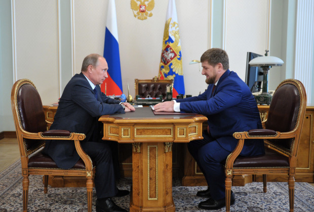 Russian President Vladimir Putin (L) speaks with Chechen leader Ramzan Kadyrov during their meeting in Novo-Ogaryovo residence outside Moscow on August 7, 2013. AFP PHOTO / RIA NOVOSTI - ALEXEY NIKOLSKY        (Photo credit should read ALEXEY NIKOLSKY/AFP/Getty Images)