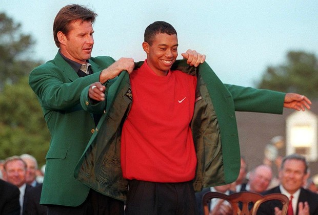 AUGUSTA, :  Tiger Woods (R) receives the Masters green jacket from 1996 Masters champion Nick Faldo after Woods won the 1997 Masters tournament 13 April at Augusta National Golf Club in Georgia. Woods set a new course record by shooting 18-under-par for the tournament.  AFP PHOTO/Timothy A. CLARY (Photo credit should read TIMOTHY A. CLARY/AFP/Getty Images)