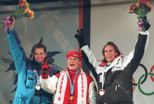 Winners of the men's Giant SLalom Snowboarding celebrate on the podium in Nagano 08 February. (L-R) Ueli Kestenholz of Switzerland (bronze) Ross Rebagliati of Canada (gold) and Thomas Prugger of Italy (silver). The medals were the first ever awarded for Olympic snowboarding.   AFP PHOTO (Photo credit should read KAZUHIRO NOGI/AFP/Getty Images)