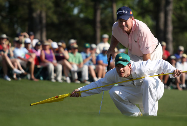 AUGUSTA, GA - APRIL 11:  Tom Watson lines up a putt on the 18th green with his son/caddie Mike during the final round of the 2010 Masters Tournament at Augusta National Golf Club on April 11, 2010 in Augusta, Georgia.  (Photo by Andrew Redington/Getty Images)