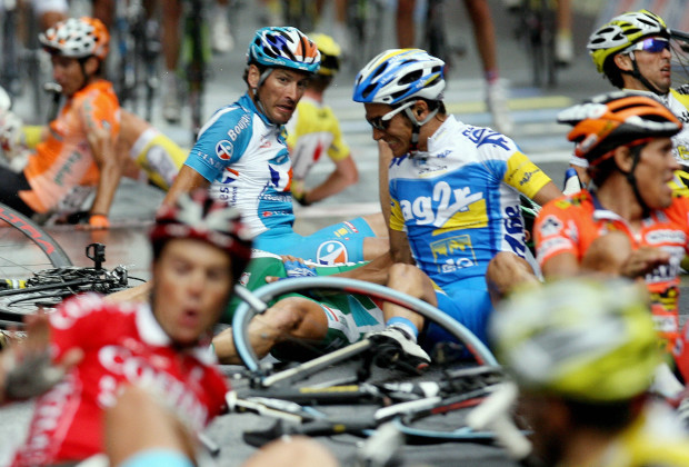 Pinerolo, ITALY: Riders lies after crashing during the final sprint of eleventh stage of the Giro d'Italia cycling race, 198 km leg from Serravalle Scrivia to Pinerolo, 23 May 2007. Italy's Alessandro Petacchi won the stage while Italy's rider Andrea Noe retains the leader's pink jersey. AFP PHOTO / ALBERTO PIZZOLI (Photo credit should read ALBERTO PIZZOLI/AFP/Getty Images)
